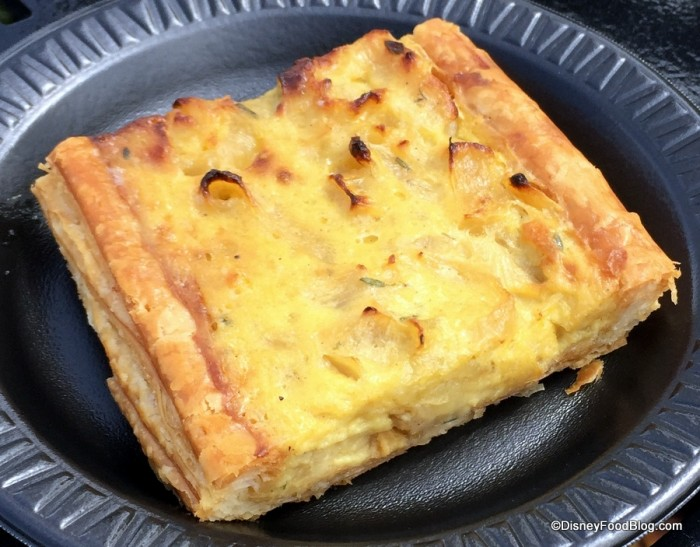 Tarte à l'Onion Alsacienne: Alsatian Onion Tart with Sautéed Onions, Fresh Thyme and Rosemary on a Flaky Puff Pastry Crust