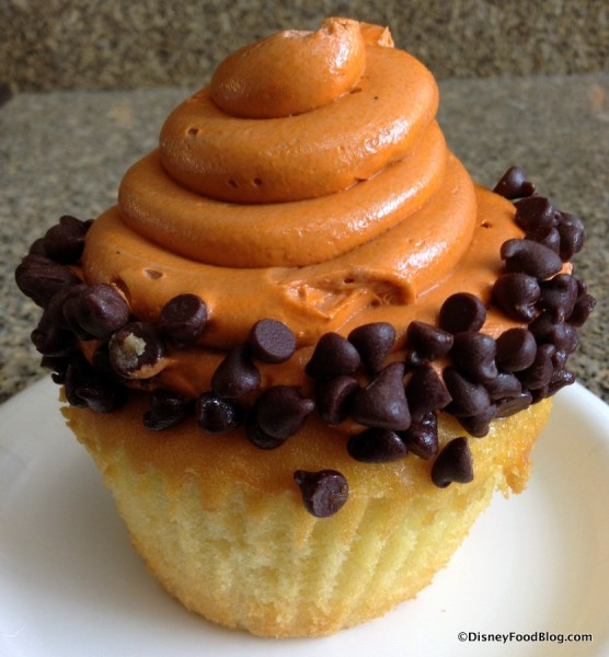 Orange-colored Icing on top of Vanilla Cake