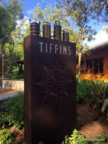Tiffins Sign, with tiffins on top