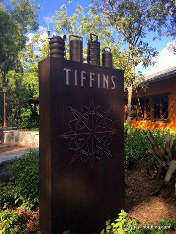 Tiffins Sign, with tiffins on top