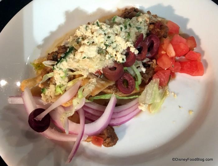 """Vegan Loaded Greek """"Nachos"""": Pita Chips, Meatless Sausage Crumbles, and Vegan Tzatziki"""