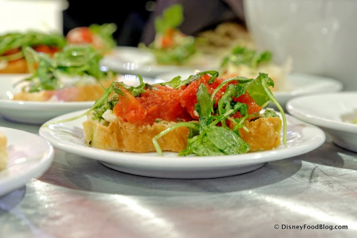 Bruschetta topped with Roasted Tomatoes, Pesto, Herbed Ricotta and Arugula