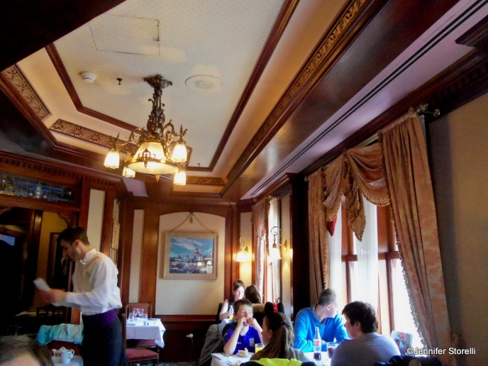 The Disneyland Hotel room is a cozy parlor overlooking Main Street, U.S.A.