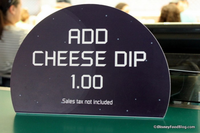 """Add Cheese Dip"" Sign at Cosmic Ray's"
