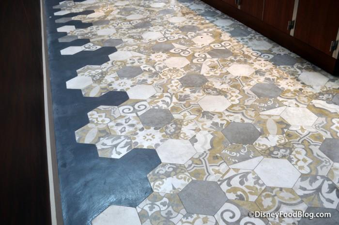 Tiles on floor by Beverage Bay