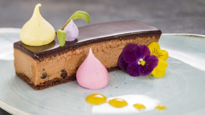 Crisp Caramel Chocolate Mousse Bar, Flavored Merengue Kisses and Passion Fruit Sauce ©Disney