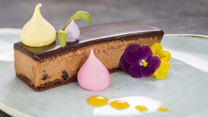 Crisp Caramel Chocolate Mousse Bar, Flavored Merengue Kisses and Passion Fruit Sauce ©Disney