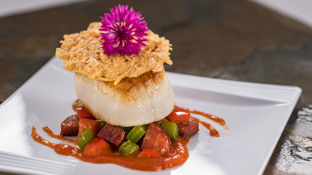 Pan-Seared Scallop with Chorizo, Roasted Red Pepper Coulis, and Parmesan Crisp -- at The Artist Table Food Studio ©Disney