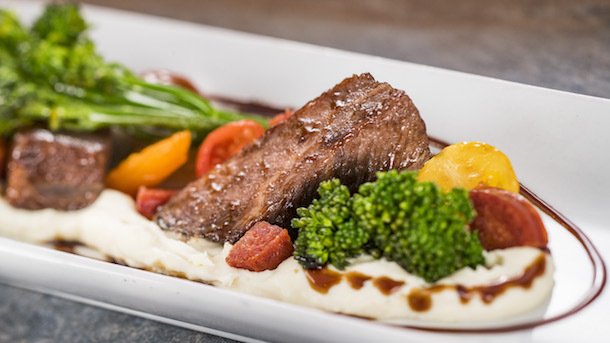 Braised Beef Short Rib with Parsnip Puree, Broccolini, Baby Tomatoes, and Aged Balsamic -- Classic Cuisine Food Studio ©Disney