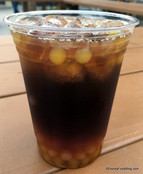 Orange iced tea with orange pearls