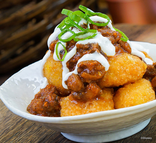 Sweet corn nuggets with beef chili, spring onions and sour cream