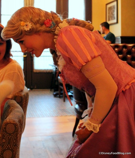 Rapunzel speaking to a young guest