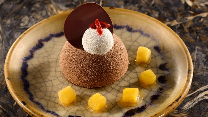 Chocolate Cake with a Crunchy Cookie, Banana Cream and Goji Berries ©Disney
