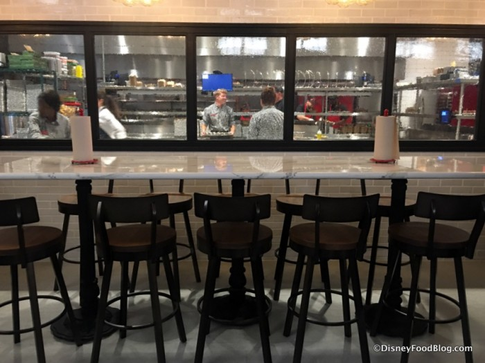 The Polite Pig bar with kitchen view