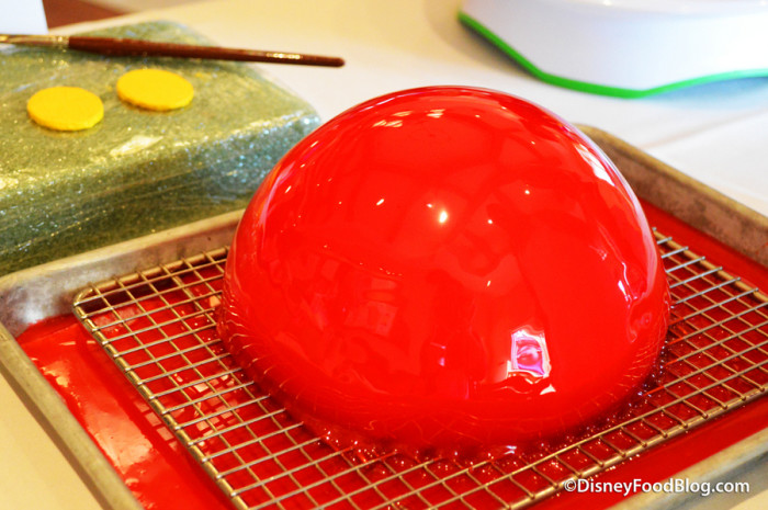 Another layer of glaze on cake