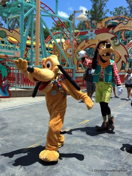 Pluto and Goofy in Dinoland, USA