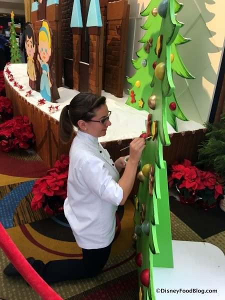 Putting the Final Touches on the Contemporary Resort Gingerbread Display