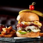 What's Topping The Edison's Burger of the Month? Check Out the Double Stack Deli Burger!