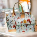 Life Is the Bubbles Thanks to the NEW Ariel Dooney & Bourke Collection Coming to Disney World!