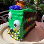 REVIEW!!! We Tasted This ODD-LOOKING Monster Halloween Cake Lurking at Disneyland!!!