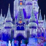 Like an Icy Blast Elsa Lights Up Cinderella Castle for the Christmas Season in Disney World!