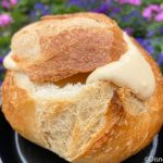REVIEW! There's a New Melted Brie Filled Bread Bowl in Epcot and We Wanna Put Our Faces IN IT!
